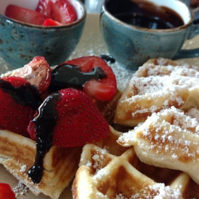 A close up of dark chocolate strawberry waffles
