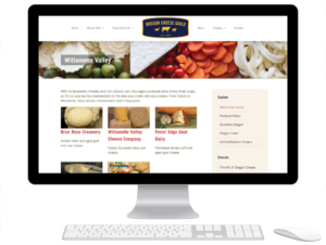 Desktop computer displaying the cheese trail section of the Oregon Cheese Guild website