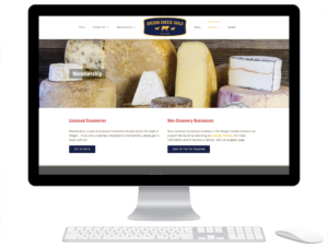 Desktop computer displaying the membership page of the Oregon Cheese Guild website